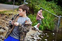 Kaleb Justus, 10, dodges his fishing lure as it swung back toward him as his brother, Nate Justus, 13, fishes from the shoreline of Fernan Lake after school Monday.