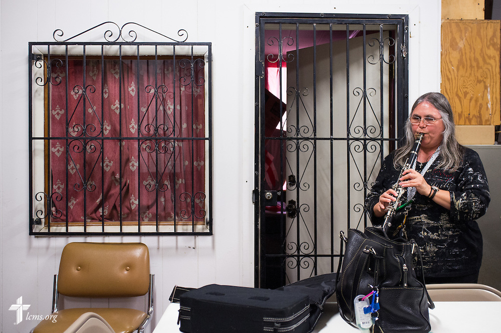 In the fellowship hall, parishioner Sara Zambrano warms up before worship with her clarinet at El Calvario Lutheran Church on Sunday, April 17, 2016, in Brownsville, Texas. LCMS Communications/Erik M. Lunsford