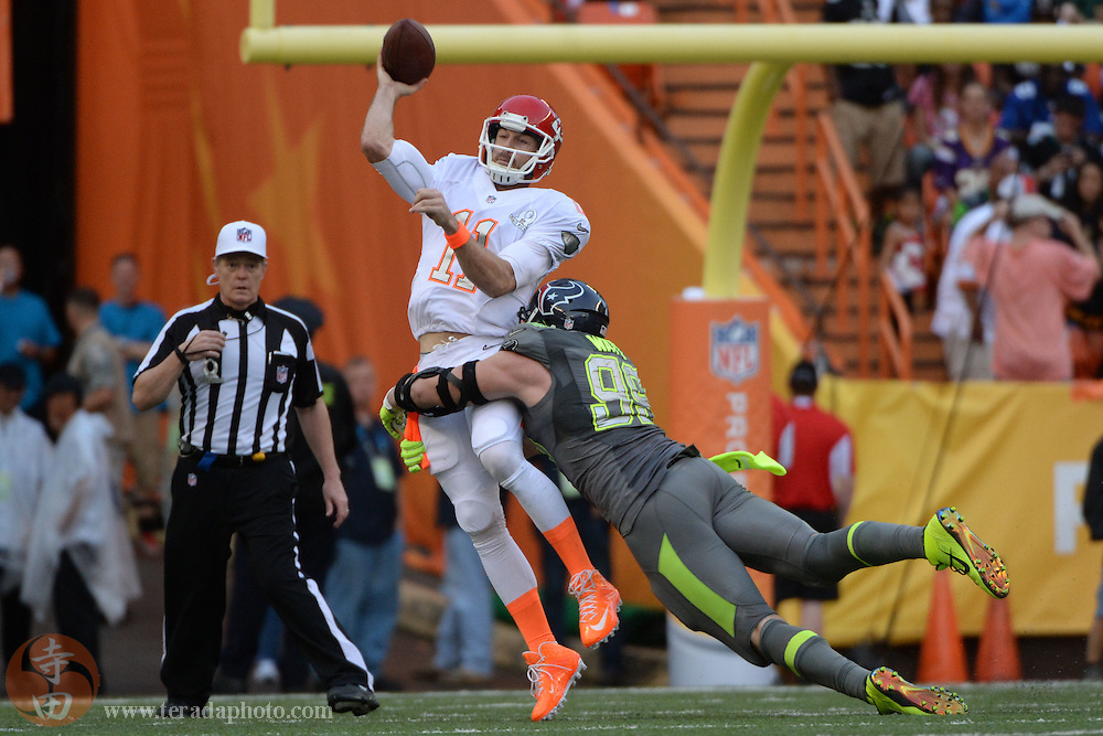January 26, 2014; Honolulu, HI, USA; Team Rice quarterback Alex Smith of the Kansas City Chiefs (11) passes the football against Team Sanders defensive end J.J. Watt of the Houston Texans (99) during the fourth quarter of the 2014 Pro Bowl at Aloha Stadium. Team Rice defeated Team Sanders 22-21.