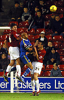 Photo: Dave Linney.<br />Walsall v Torquay United. Coca Cola League 2. 04/11/2006. Walsall defenders Ian Roper(L) & Scott Dann(R)  clear the ball before Lee Thorpe can pounce.