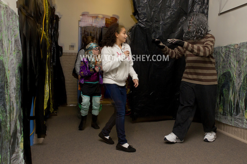 Middletown, New York  - A monster scares people during the Halloween Fall Festival at the Middletown YMCA Center for Youth Programs on Oct. 26, 2013.