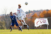 CVU's Joe Parento (12) leaps over Mt Anthony's Carter Bentley (9) to head the ball during the boys semifinal soccer game between Mount Anthony and Champlain Valley Union at CVU high school on Tuesday afternoon October 27, 2015 in Hinesburg. (BRIAN JENKINS/ for the FREE PRESS)