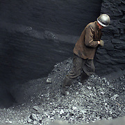 Lan Ba Coal Mine on the Laoying mountain in South West China is an illegal coal mine. Normally, these are run by a business man in complicity with a local sheriff. Illegal coal mines are often situated in the inner parts of mountains and very small. The miners are often recruited among migrant workers with a farming background.
