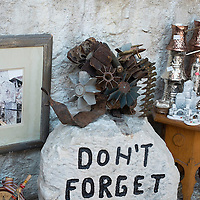 """MOSTAR, BOSNIA AND HERZEGOVINA - JUNE 28:  A """"Don't Forget Sign"""" is seen on June 28, 2013 in Mostar, Bosnia and Herzegovina. The Siege of Mostar reached its peak and more cruent time during 1993. Initially, it involved the Croatian Defence Council (HVO) and the 4th Corps of the ARBiH fighting against the Yugoslav People's Army (JNA) later Croats and Muslim Bosnian began to fight amongst each other, it ended with Bosnia and Herzegovina declaring independence from Yugoslavia.  (Photo by Marco Secchi/Getty Images)"""