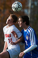 CVU's Nate Coffin (14) and Mt. Anthony's Thomas Hendery (2) leap to head the ball during the boys semifinal soccer game between Mount Anthony and Champlain Valley Union at CVU high school on Tuesday afternoon October 27, 2015 in Hinesburg. (BRIAN JENKINS/ for the FREE PRESS)