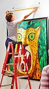 Young woman preparing booth at Art Basel Miami Beach 2011