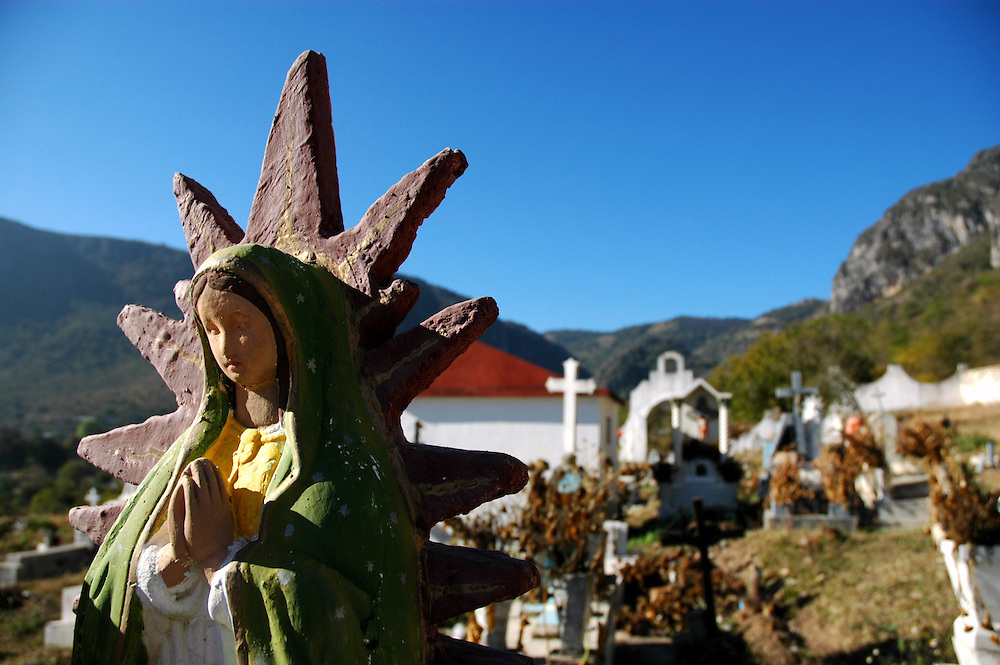 "..""Statue of the Virgin of Guadalupe, on a grave at the cemetery in Santiago Apoala"""