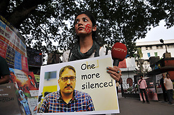 June 15, 2018 - Kolkata, West Bengal, India - Indian Journalist and Photojournalist silent candle light pray and protest the Journalist killing issue ,Recently slain editor-in-chief of the Srinagar-based newspaper Rising Kashmir Shujaat Bukhari was leaving his office in Srinagar on Thursday evening when three assailants roared up and fired several shots from close range. on June 15,2018 in Kolkata.India. (Credit Image: © Debajyoti Chakraborty/NurPhoto via ZUMA Press)