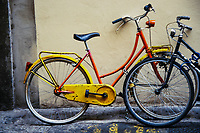 A bicycle parked on the street of an Italian city.