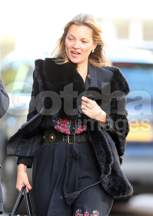 Kate Moss out on a windy day in North London. The supermodel wearing a black fur coat, black dress a knee high boots enjoyed a Japanese lunch with a friend. UK. 30/10/2013<br />BYLINE MUST READ : JAMESY/GOTCHA IMAGES<br /><br />Copyright by © Gotcha Images Ltd. All rights reserved.<br />Usage of this image is conditional upon the acceptance <br />of Gotcha Images Ltd, terms and conditions available at<br />www.gotchaimages.com