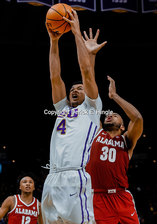 Jan 13, 2018; Baton Rouge, LA, USA; LSU Tigers guard Skylar Mays (4) is defended by Alabama Crimson Tide forward Galin Smith (30) during the second half at the Pete Maravich Assembly Center. Alabama defeated LSU 74-66.  Mandatory Credit: Derick E. Hingle-USA TODAY Sports