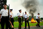 Members of the American Legion break out of formation during the flag retirement ceremony held at American Legion Post 211 in Sayreville on June 14, 2011.  American Legion Post 211 retired hundreds of flags during the ceremony.