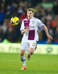 CARDIFF, WALES - Tuesday, February 11, 2014: Aston Villa's Marc Albrighton in action against Cardiff City during the Premiership match at the Cardiff City Stadium. (Pic by David Rawcliffe/Propaganda)