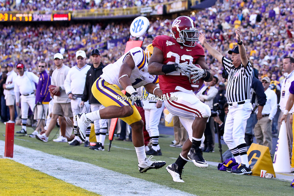 November 6, 2010; Baton Rouge, LA, USA; Alabama Crimson Tide running back Mark Ingram (22) runs past LSU Tigers cornerback Eric Reid (1) for a touchdown during the second half at Tiger Stadium. LSU defeated Alabama 24-21.  Mandatory Credit: Derick E. Hingle