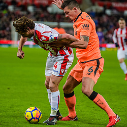 Stoke City midfielder Joe Allen (4) challenged by Liverpool defender Dejan Lovren (6) during the Premier League match between Stoke City and Liverpool<br /> (c) John Baguley | SportPix.org.uk