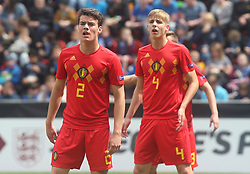 May 17, 2018 - United Kingdom - L-R Lucas Lissens of Belgium Under 17 and Lars Dendoncker of Belgium Under 17.during the UEFA Under-17 Championship Semi-Final match between Italy U17s against Belgium U17s at New York Stadium, Rotherham United FC, England on 17 May 2018. (Credit Image: © Kieran Galvin/NurPhoto via ZUMA Press)