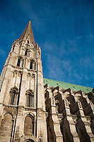 """Our Lady of Chartres Cathedral, Chartres, France. The south """"Pyramid"""" Tower against a blue sky in the morning."""