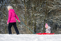 © Licensed to London News Pictures. 28/02/2018. Leeds UK. Picture shows Margaret Davies pulling her two year old granddaughter Scarlet through the snow in Temple Newsam park in Leeds today as the beast from the east batters the UK. Photo credit: Andrew McCaren/LNP