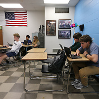 Thomas Wells | BUY at PHOTOS.DJOURNAL.COM<br /> Ryan Malone, right, and Stewart Samples sit all alone as they take a trivia quiz on the cold war at Tupelo High School.