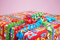 Present wrapped with colourful paper, close-up