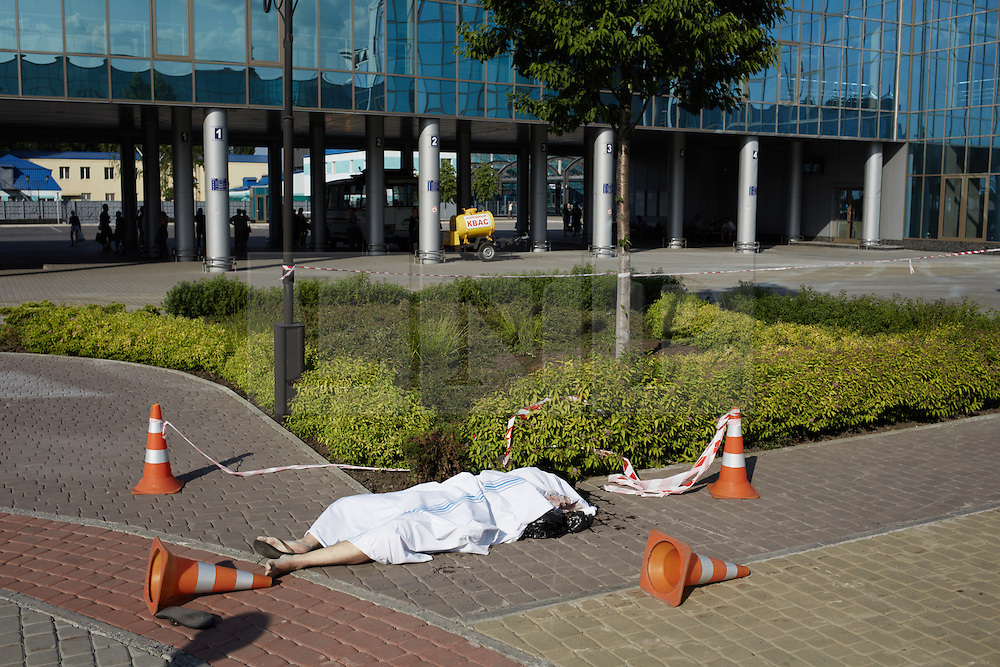 © Licensed to London News Pictures. Donetsk 26/05/14. A civilian casualty near Donetsk Railway station. Killed in crossfire between Ukraine Army and Pro-Russia Separatists. Credit: Christopher Nunn/LNP