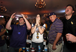 09 January 2012. New Orleans, Louisiana, USA.  <br /> BCS Championship. LSU fans watch nervously on as the Crimson Tide rolls over LSU as Alabama trounces LSU 21-0 to take the Championship for the second year in a row. Students and fans pored onto Bourbon Street as the partying carried on late into the night. Alabama fans celebrated as LSU fans commiserated.<br /> Photos; Charlie Varley