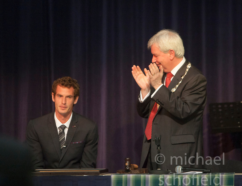 Andy break during his short speech. Andy Murray received the Freedom of Stirling from Stirling Council, who have recognised the Wimbledon champion's sporting achievements at a special council meeting at Dunblane High School.<br /> &copy; Michael Schofield.