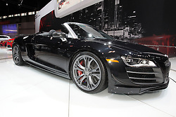 08  February 2013: Audi R8 GT Spyder convertible sports car.  Chicago Auto Show, Chicago Automobile Trade Association (CATA), McCormick Place, Chicago Illinois<br /> <br /> 2013 AUDI A8/S8: Audi expanses its 2013 A8 flagship series from two (V-8 and W12) to a five vehicle line up (3.0T V6, 4.0T A8, 4.0T S8 and W12). The new 3.0-liter supercharged V-6 engine generates 333 horsepower that delivers better performance and makes entry into the A8 model line available to more buyers. The all-new 4.0L twin-turbo V-8 is faster and more powerful than the outgoing 4.2L. All engines are mated to an eight-speed Tiptonic automatic transmission with Audi quattro all-wheel drive system. While the 3.0T and 4.0T are offered in normal and long wheelbase versions, the S8 and the A8 W12 can be ordered only in normal and long wheelbase versions respectively. All A8s seat five passengers, and with the executive rear seating package available in the Audi A8 L and the A8 L W12, you're upgraded to a reclining relaxation seat with a power footrest, dual 10-inch video screens and a refrigerator. For further improvements in fuel economy, Audi has implemented Audi cylinder on demand technology for the new 4.0T V-8 engine and start-stop technology for the V-6. For the more performance-oriented driver, the Audi S8 is equipped with a 4.0L, twin-turbo V-8 that generates 512 horses and 479 lb-ft. of torque - making it the most powerful sedan in Audi of America's history. Acceleration from 0 to 60 takes a mere 3.9 seconds. Bringing the S8 to a safe stop are the high performance ventilated disc brakes, with matte black painted calipers that carry the S8 logo.