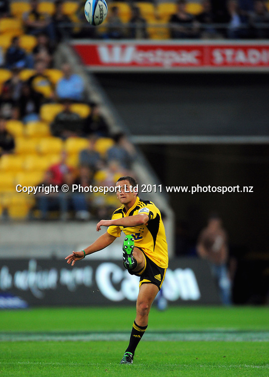 Hurricanes first five Aaron Cruden takes a restart. Super 15 rugby match - Hurricanes v Highlanders at Westpac Stadium, Wellington, New Zealand on Friday, 18 February 2011. Photo: Dave Lintott/PHOTOSPORT