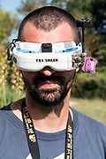 portrait of a person wearing drone navigation goggles