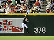 Jul 10, 2013; Phoenix, AZ, USA;  Arizona Diamondbacks outfielder Cody Ross (7) catches a fly ball out hit by the Los Angeles Dodgers infielder Mark Ellis (not pictured) in the first inning at Chase Field. Mandatory Credit: Jennifer Stewart-USA TODAY Sports