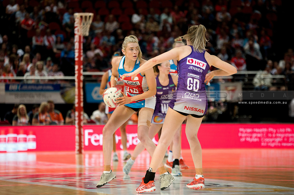 SYDNEY, AUSTRALIA - AUGUST 24: Helen Housby of the Swifts looks to pass the ball during the round 14 Super Netball match between the Swifts and the Queensland Firebirds at Qudos Bank Arena on August 24, 2019 in Sydney, Australia.(Photo by Speed Media/Icon Sportswire)