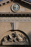 View from below of the clock face, pediment and carved inscription on the neo-classical amphitheatre built in 1787 and 1788 by Edme Verniquet, located in the Jardin des Plantes, Paris, 5th arrondissement, France. Founded in 1626 by Guy de La Brosse, Louis XIII's physician, the Jardin des Plantes, originally known as the Jardin du Roi, opened to the public in 1640. It became the Museum National d'Histoire Naturelle in 1793 during the French Revolution. Picture by Manuel Cohen