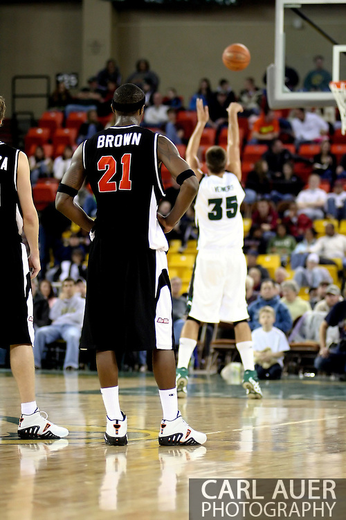 11/25/2006 - Anchorage, Alaska: Sophomore forward Anthony Brown (21) of the Pacific Tigers watches Stephen Verwers (35) shoot a free throw after Brown was called for a intentional foul as Hawaii beat Pacific 71-60 to give the Warriors a third place finish in the 2006 Great Alaska Shootout<br />