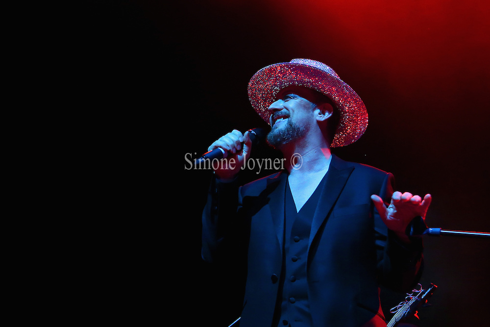 (EDITORIAL USE ONLY) Singer Boy George performs live on stage at Indigo2 at O2 Arena on April 3, 2014 in London, England.  (Photo by Simone Joyner)