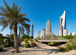 Daytime skyline of downtown Kuwait City at bird aviary in Al Shaheed Park in Kuwait, Middle East