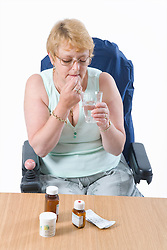 Female wheelchair user taking course of drugs to treat MS,