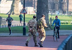 © Licensed to London News Pictures. 27/03/2020. London, UK. Soldiers walk down Horse Guards Road while Londoners go out to exercise as Prime Minister Boris Johnson orders police to enforced the lockdown with fines being given out to people for travelling in to London without good reason as the coronavirus crisis continues. Photo credit: Alex Lentati/LNP