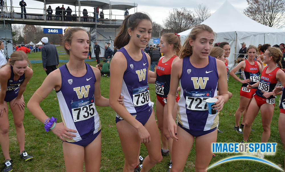 Nov 21, 2015; Louisville, KY, USA; Charlotte Prouse (735), Maddie Meyers (730) and Katie Knight (727) of Washington react after the womens race during the 2015 NCAA cross country championships at Tom Sawyer Park.