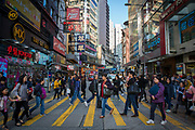 Pedestrians crossing in front of a Pizza Hut on Lockhart Road, Causeway Bay, Hong Kong. (photo by Andrew Aitchison / In pictures via Getty Images)