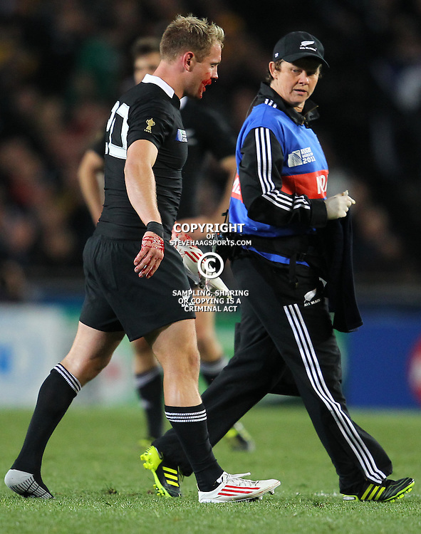 AUCKLAND, NEW ZEALAND - OCTOBER 16, Andrew Ellis helped from the field with an injury during the 2011 IRB Rugby World Cup Semi Final match between New Zealand and Australia at Eden Park on October 16, 2011 in Auckland, New Zealand<br /> Photo by Steve Haag / Gallo Images