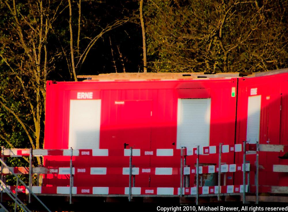 Bright red construction huts at Werdhölzli Sewage Treatment Plant, Zürich, Switzerland.