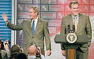 President George W. Bush and his brother, Florida Governor Jeb Bush, have an interesting placement during a speech by the president in Sun City Center, Florida.