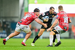 Phil Dollman of Exeter Chiefs is challenged by Val Rapava Ruskin of Gloucester Rugby and Ed Slater of Gloucester Rugby - Mandatory by-line: Ryan Hiscott/JMP - 24/11/2018 - RUGBY - Sandy Park Stadium - Exeter, England - Exeter Chiefs v Gloucester Rugby - Gallagher Premiership Rugby