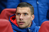 Lukas Podolski of Arsenal on the substitute's bench before the UEFA Champions League match at the Emirates Stadium, London<br /> Picture by David Horn/Focus Images Ltd +44 7545 970036<br /> 04/11/2014
