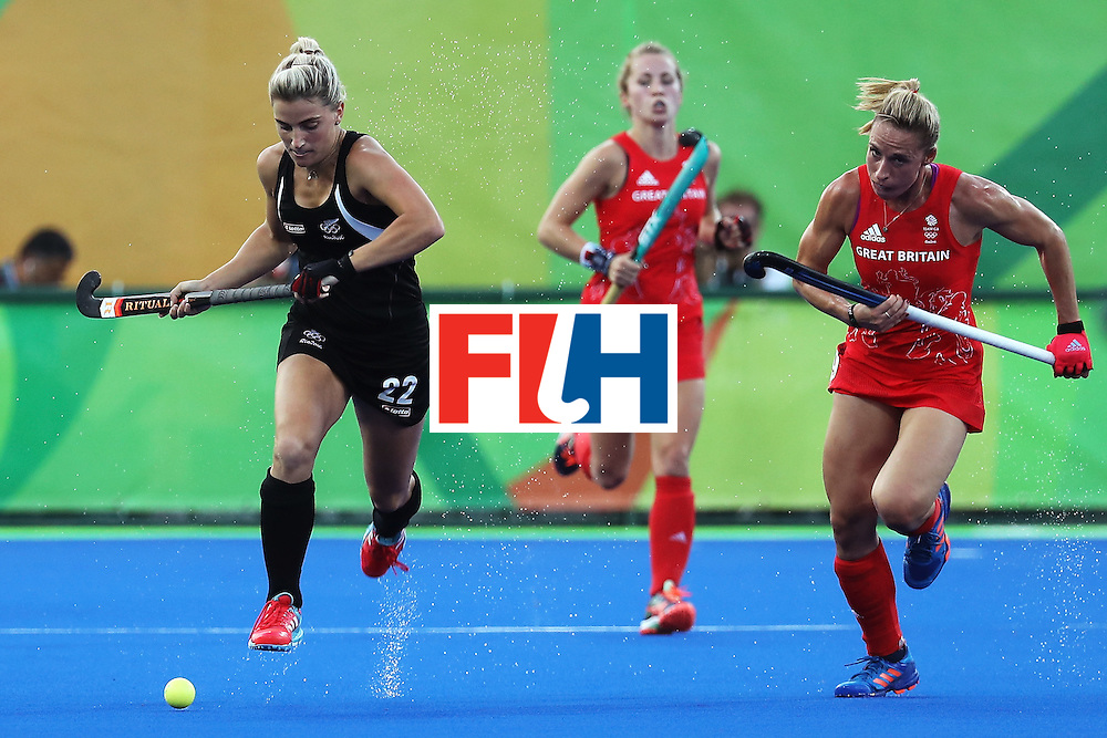 RIO DE JANEIRO, BRAZIL - AUGUST 17:  Liz Gemma Flynn #22 of New Zealand and Susannah Townsend #9 of Great Britain in action during the Women's Semifinal match between New Zealand andGreat Britain on Day 12 of the Rio 2016 Olympic Games at the Olympic Hockey Centre on August 17, 2016 in Rio de Janeiro, Brazil.  (Photo by Rob Carr/Getty Images)