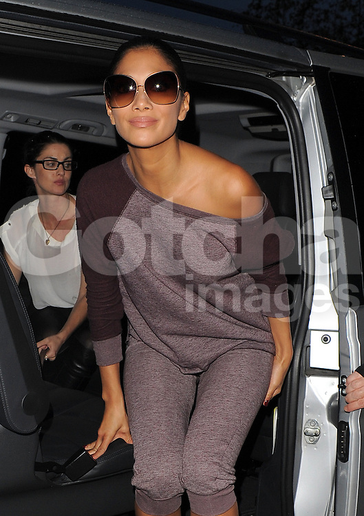 X Factor Judge Nicole Scherzinger wearing a purple tracksuit and a pair of leopard print boots, arriving a London hotel after a photo shoot. UK. 02/10/2012<br />BYLINE MUST READ : GOTCHAIMAGES.COM<br /><br />Copyright by &copy; Gotcha Images Ltd. All rights reserved.<br />Usage of this image is conditional upon the acceptance <br />of Gotcha Images Ltd, terms and conditions available at<br />www.gotchaimages.com