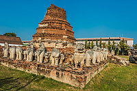 chedi surrounded by lion statues in Wat Thammikarat temple at Ayutthaya Bangkok Thailand