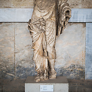 Statue of a woman. Early 4th century BC. The Stoa of Attalos is a 1950s recreation of a long pavilion that was originally built around 150 BC. It was part of the Ancient Agora (market). It now houses the Museum of the Ancient Agora, which includes clay, bronze and glass objects, sculptures, coins and inscriptions from the 7th to the 5th century BC, as well as pottery of the Byzantine period and the Turkish conquest.
