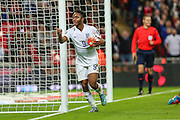 England's Raheem Sterling  celebrates scoring his teams 2nd goal during the UEFA European 2016 Qualifier match between England and Estonia at Wembley Stadium, London, England on 9 October 2015. Photo by Shane Healey.